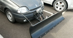 Snow plow attached to small Renault car stock video