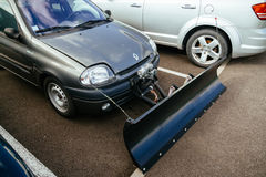 Snow plow attached to small Renault car Royalty Free Stock Photography