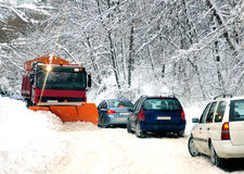 Snow plow cleaning the road. Snow plow cleaning mountain road, traffic jam Royalty Free Stock Image