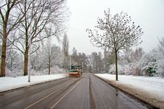 Snow plow cleaning the road in the countryside from the Netherlands. Snow plow cleaning the road in the countrye from the Netherlands in winter Royalty Free Stock Photo
