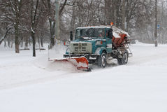 Snow plow cleaning snow Stock Photo
