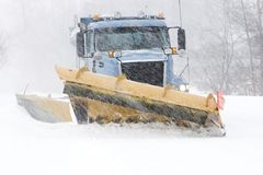 Snow plow cleaning street Royalty Free Stock Photo