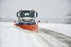Snow plow clearing a snowy road Royalty Free Stock Photo