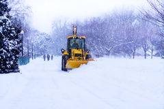 Snow plow clears the road. Stock Photo