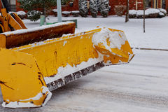 Snow plow doing  removal after a blizzard in Chicago suberb. Stock Photo