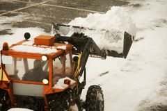 Snow Plow Machine. A snow plow clearing a parking lot Royalty Free Stock Photo