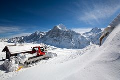 Snow plow on mountainside Stock Photo