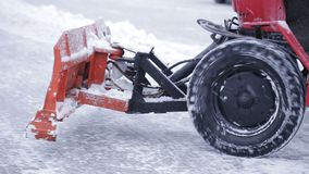 Snow plow outdoors cleaning street. snowplow removing fresh snow from city square. Tractor cleaning snow in the park. Snow plow outdoors cleaning street stock video footage