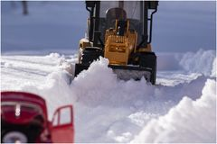 Snow plow on the road and keep the snow on the roads. stock photo