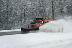 Snow plow on the road Stock Image