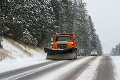 Snow plow on the road Stock Photography