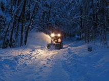 Snow plow on tractor Stock Image