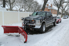 Snow plow truck in Brooklyn, NY ready to clean streets after massive Winter Storm Helen strikes Northeast Stock Image