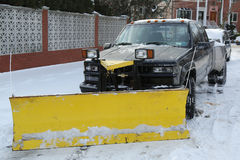 Snow plow truck in Brooklyn, NY ready to clean streets after massive Winter Storm Helen strikes Northeast Stock Photo