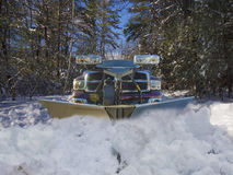 Snow plow truck. Clearing the driveway of snow Stock Photography