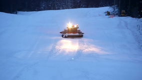 Snow plow truck on ski slope stock footage