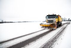 Snow plow on the winter road royalty free stock photos