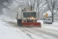 Snow plowing Stock Images