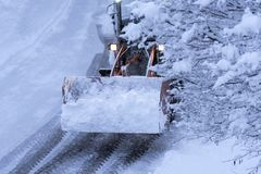 Snow plowing Royalty Free Stock Photos