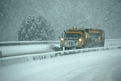 Snow plows clearing highway Stock Images