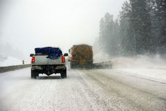 Snow plows keep the road open Stock Photo