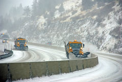 Snow plows keep the road open royalty free stock photo