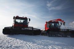 Snow plows in mountains Stock Photo