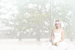 Snow Princess - Girl sitting in snow - floral head wreath Royalty Free Stock Photo