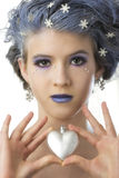 Snow Princess and the Heart. Young girl posed as a snow princess holding a heart Royalty Free Stock Photography