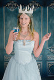 Snow princess holding a drink Royalty Free Stock Photos