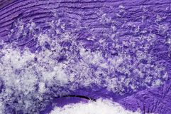 Snow on the purple surface! Stock Image