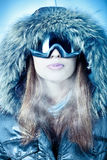 Snow Qeen - DINOTOPIA. Portrait of a woman in a hood and goggles executed in cold tones Royalty Free Stock Image