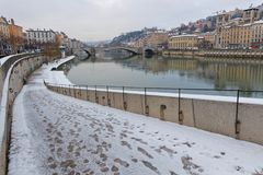 Snow on the quay of Saone river. LYON, FRANCE, March 1, 2018 : Saone river banks as a cold spell rages in all Europe and the Capital of Gallia is under the snow Royalty Free Stock Photo