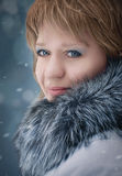 Snow queen. Winter portrait of the young girl in a fur coat Stock Images