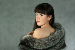 Snow queen. The beautiful Girl in a fur cape royalty free stock images