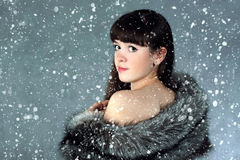 Snow queen. The beautiful Girl in a fur cape royalty free stock photo