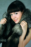 Snow queen. The beautiful Girl in a fur cape royalty free stock image