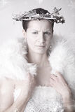 Snow Queen. Frowning snow queen, ready for winter to begin Royalty Free Stock Photos