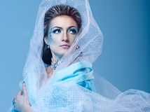Snow Queen. Attractive young girl with a theatrical makeup on the face in the image fabulous snow queen Stock Photo