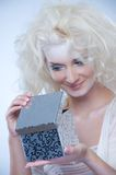 Snow queen with a christmas box Royalty Free Stock Images