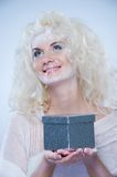 Snow queen with a christmas box Stock Photo