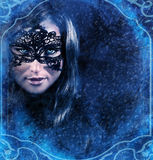 Snow queen. Closeup portrait of gorgeous snow queen in snowy night looking through window, misterious woman looking wearing beautiful mask, fairy tale concept Stock Images