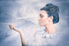 Snow queen concept blowing over a crystal. Beautiful snow queen concept blowing over a crystal on frozen background Stock Images