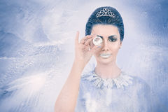 Snow queen concept looking through a crystal. Beautiful snow queen concept looking through a crystal on frozen background Stock Images