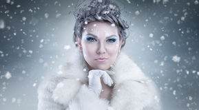 Snow queen. Over snowy background Royalty Free Stock Photo