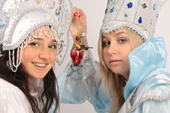 Snow Queen and Snow Maiden. Girls in costumes Snow Queen and Snow Maiden Tree Stock Photos