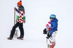 Snow Queen Trophy. ZAGREB, CROATIA - JANUARY 3, 2018 : Janica Kostelic with her nephew on the ski run of the Audi FIS Alpine Ski World Cup Women`s Slalom, Snow stock image