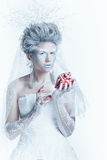 Snow queen with an unusual makeup and heart in hands Royalty Free Stock Image