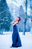Snow queen winter yong girl in forest. Beautiful snow queen winter yong girl, rad hair, fairy tale royalty free stock images