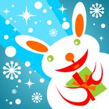 Snow rabbit with gift Royalty Free Stock Images